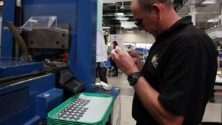 Staff at the Royal Mint in Wales are getting the coins ready