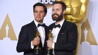 Shan Christopher Ogilvie (left), and Benjamin Cleary pose with their Oscars for Best Short Film (Live Action)