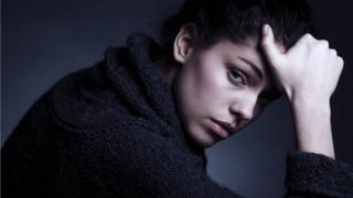 Depressed woman looking at camera