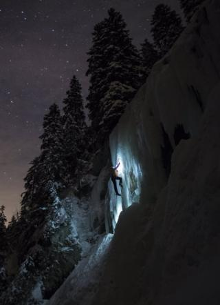 A climber moves up an ice cascade in Switzerland.