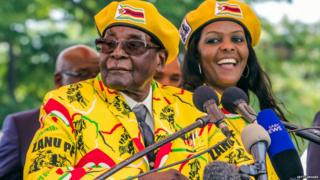 Robert Mugabe (L) addresses party members and supporters gathered at his party headquarters to show support to Grace Mugabe (R) becoming the party's next Vice President after the dismissal of Emerson Mnangagwa November 8 2017.