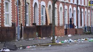 Rubbish ands debris on a street in Belfast's Holyland after St Patrick's Day