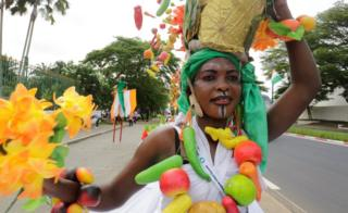 People take part in a parade during the 5th African Union - European Union (AU-EU) summit will take place is pictured in Abidjan, Ivory Coast November 30, 2017.
