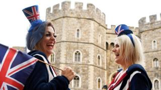 Royal supporters get into position outside of Windsor Castle ahead of the Royal wedding