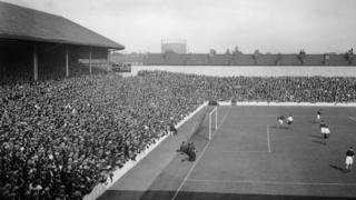 Crowds at White Hart Lane, London, watching the home side, Tottenham Hotspur, play Charlton Athletic, 27th August 1932. Spurs won the match 4-1.