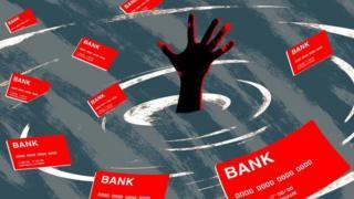 Una mano se ahoga en deudas.