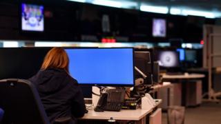 Woman at a screen at GCHQ (file pic)