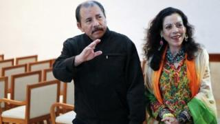 Nicaraguan President Daniel Ortega (left) next to his wife Rosario Murillo (04 December 2013)