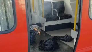 A passer-by took this photo of what's thought to be the bomb inside the train.