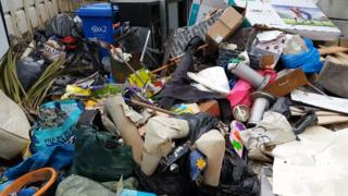 A pile of illegally-dumped rubbish in Denbighshire