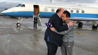 Xiyue Wan (right), who was held in Iran for three years, was greeted by US Ambassador to Switzerland Edward McMullen