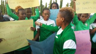 The Falcons protesting outside the National Assembly in Abuja Wednesday morning