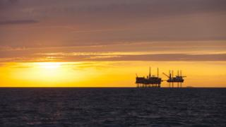 Sunset over North Sea platform