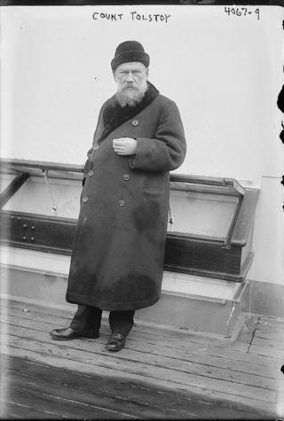 Count Tolstoy stands on board the deck