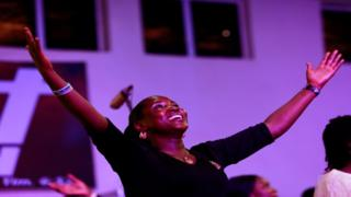 A worshipper expresses joy during church service at Living Faith Church in Abuja, Nigeria - Sunday 22 March 2020