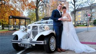Craig and Kirsty Williams next to a vintage car
