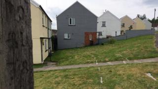 White markings on grass outside homes on Heol Scwrfa