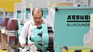 Worker at India-Dreusicke engineering firm in Berlin, 2008 file pic
