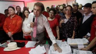 Salvador Nasralla, presidential candidate for the Opposition Alliance Against the Dictatorship, shows the tallies of ballot counting during a news conference in Tegucigalpa, Honduras November 29, 2017.