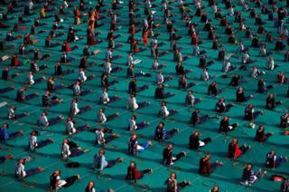 School children attend a yoga session.