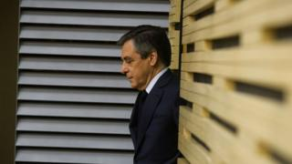 "French ""Les Republicains"" party candidate for 2017 presidential election Francois Fillon arrives to take part in a meeting"