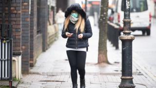 Woman in Cardiff wearing a mask on 17 March