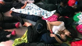 """A handout photo made available by NGO """"SOS Mediterranee"""" shows migrants resting on the ship Aquarius, in the Mediterranean Sea, 14 June 2018"""