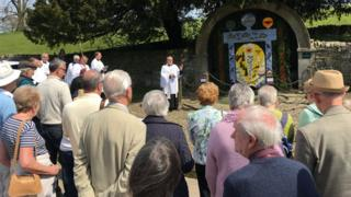 Clergy bless the wells