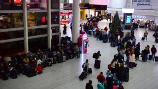 A queue snakes around Gatwick airport