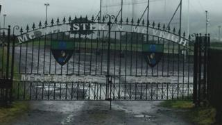 Gates with names of two IRA men