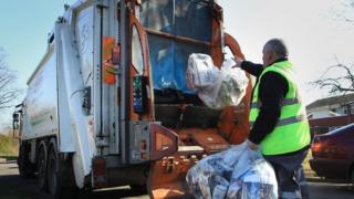 Bin contractor collects recycled waste material