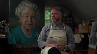 Colin Davidson beside his portrait