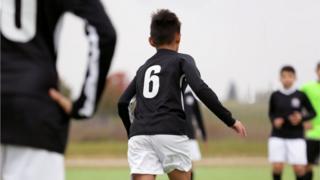 footballer wears number six