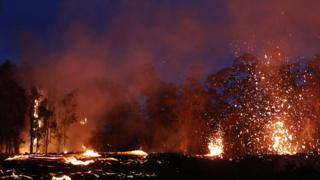 Lava erupts following eruptions at the Kilauea volcano on Hawaii's Big Island on 17 May 2018 in Kapoho, Hawaii