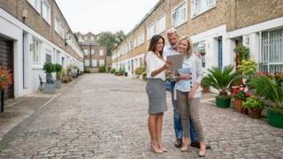 estate agent and clients
