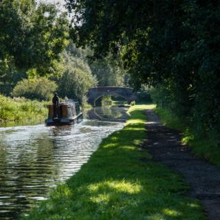 A canal boat on water