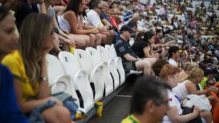 Spectators and empty seats at the beach volleyball venue in Copacabana beach during the 2016 Rio Olympics