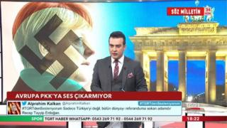 "Screen from Turkish TV station TGRT Haber, showing Angela Merkel with a Nazi swastika superimposed across her face next to Germany's Brandenburg gate. The caption reads ""Europe does not say anything to the PKK"". the PKK is classified as a terrorist group by Turkey."
