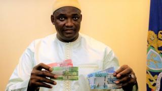 Gambia president Adama Barrow with di new note
