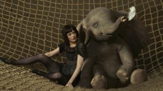 Eva Green as Colette with Dumbo the elephant