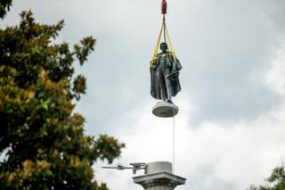 in_pictures A statue of John C Calhoun is lifted from its pedestal