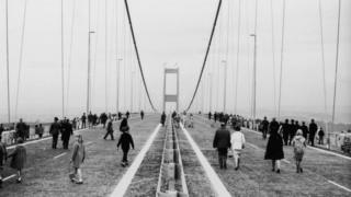 People walking along the Severn Bridge