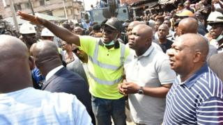 Lagos State Govnor, Akinwunmi Ambode (M); General Manager, Lagos State Emergency Management Agency (LASEMA), Tiamiyu Adesina (L) and Chairman, Lagos State Neighbourhood Safety Corp (LNSC), Rtd. A.I.G Israel Ajao (R) during di Govnor visit towia di building collapse for Massey Street, Ita-Faaji, Lagos Island, on Wednesday, March 13, 2019.