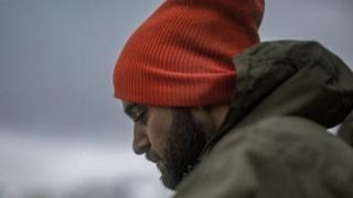 Чоловік у шапці