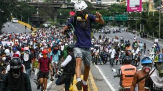 Opposition sympathizers participate in a protest against the Government in Caracas, Venezuela