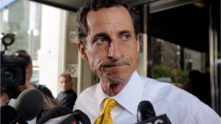 In this July 24, 2013 file photo, former New York Rep. Anthony Weiner leaves his apartment building in New York.