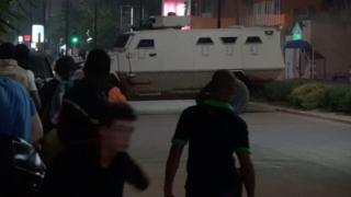 An armoured vehicle opens fire in the direction of a restaurant following an attack by gunmen in Ouagadougou, Burkina Faso