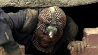 Miner in one of South Africa's abandoned mines