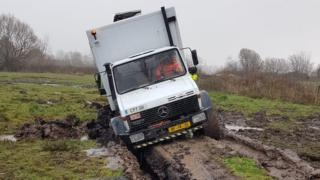 A Unimog vehicle stuck in peaty soil