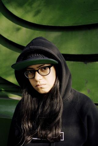 Sara Abdel-Hamid in front of a green wall.